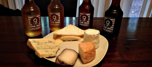 The cheese is in the following order from 12 o'clock:  Cottonbell, Dirt Lover, Mont St. Francis, Monte Enebro, Pt. Reyes Original Blue.