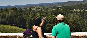 Visiting couple admire the view from Skinner Vineyards, which speciaizes in  Rhône-style wines. Other El Dorado County vineyards and wineries produce more than 70 grape varieties.