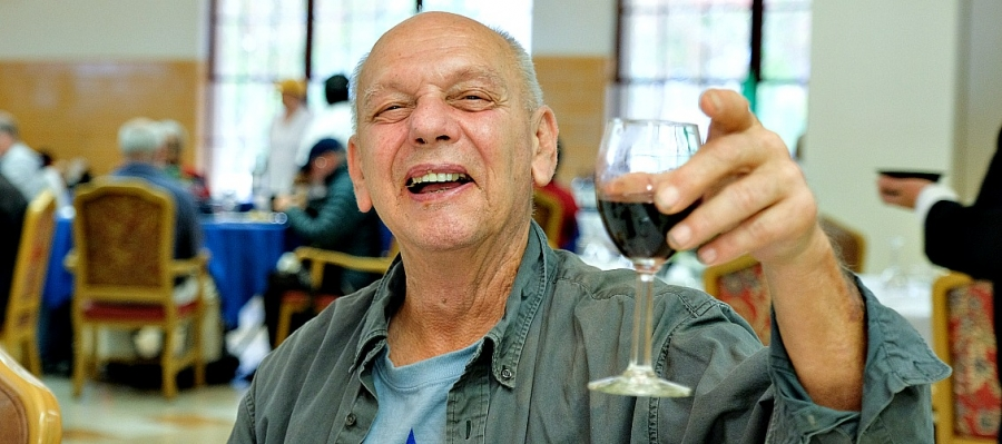 It might be a Merlot or another red wine from Duckhorn. Whatever is in his glass, this veteran seems to be enjoying it.