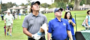 "Phi; Mickelson launches winning cork pop in Korbel ""Spray Off"" as Korbel owner Gary Heck watches"