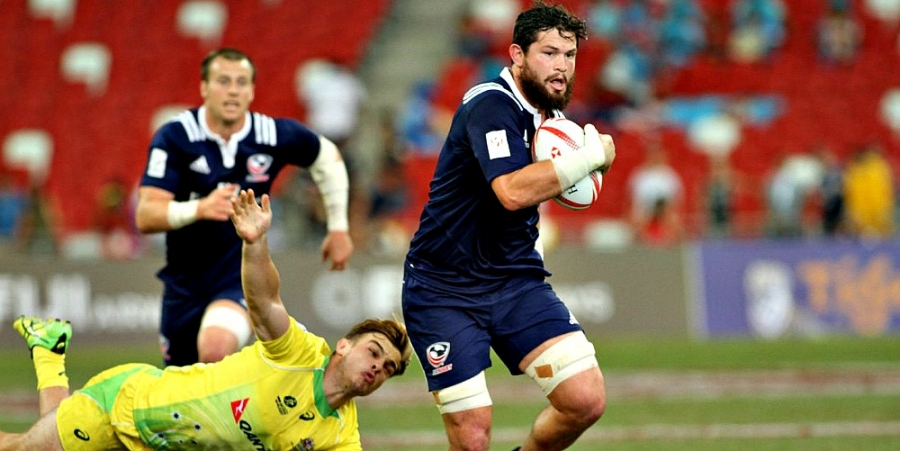 Danny Barrett of the USA pulls away from Australian defender in action this year.