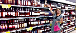 My Sister in the Rose Wine Aisle for a French Grocery Store