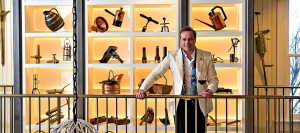 Jean Charles Boisset against a backdrop of historical artifacts at the new 1881 Napa Museum