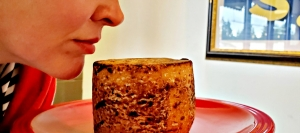 Rachael sniffs Tomme Brulee, a sheep's milk tiny tomme from the Midi Pyrenees