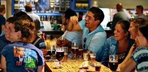 Guests enjoy atmosphere and the beer at Mike Hess Brewing.in San Diego
