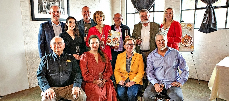 Representatives of wineries profiled in Wine Country Table pose with author Janet Fletcher at Mulvaney's lunch.