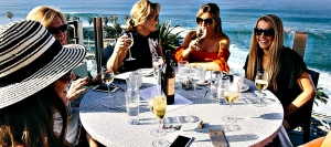 Friends enjoy pre-dinner drinks on the deck of George's at the Cove in La Jolla