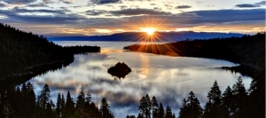 Sun bursts over Emerald Bay at daybreak