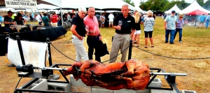 Barbera and Sangiovese tasters eye whole roasted pig they'll soon be tasting.in Four Fires' Italian area.