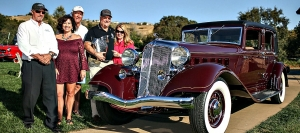 Leroy Nannini and friends celebrate 2017 Best of Show reognition for his 1933 Chrysler Imperial C.C. Sedan