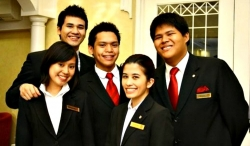 Anthony Salazar (in center) with fellow aspirational hoteliers at Enderun College in 2010